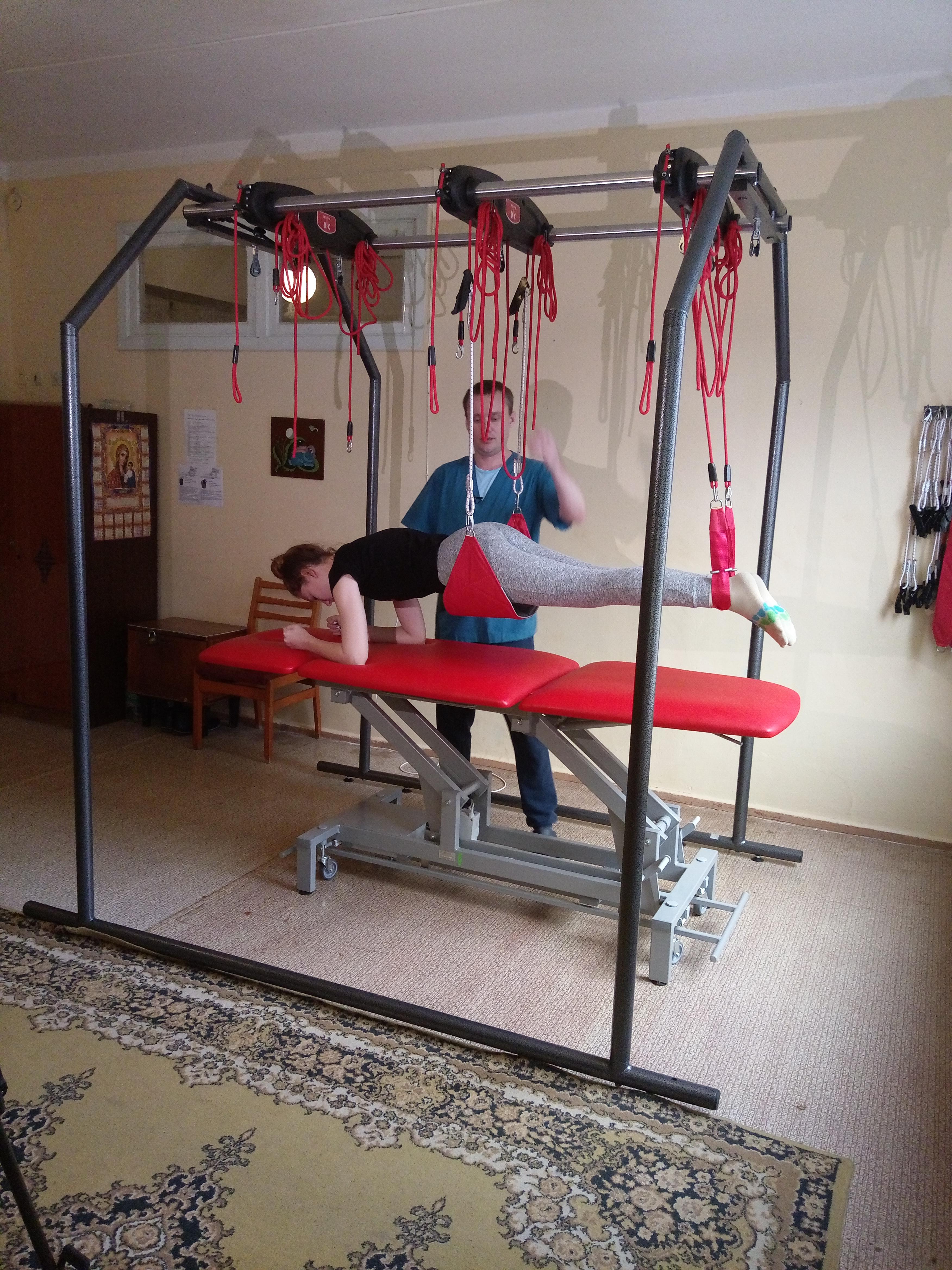 занятие на кинезотерапевтической установке Экзарта